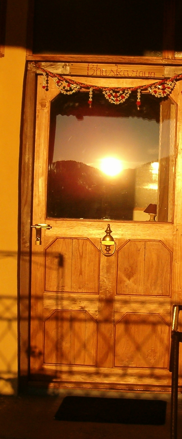door reflecting sunrise